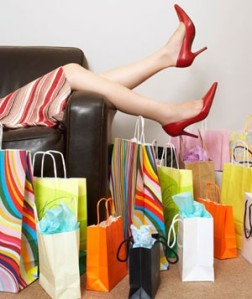 Picture of woman surrounded by lots of shopping bags