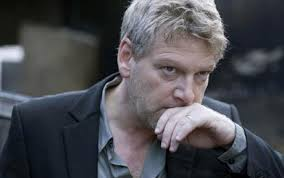 Kenneth Branagh wiping mouth