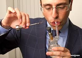 Guy in suit smoking bong